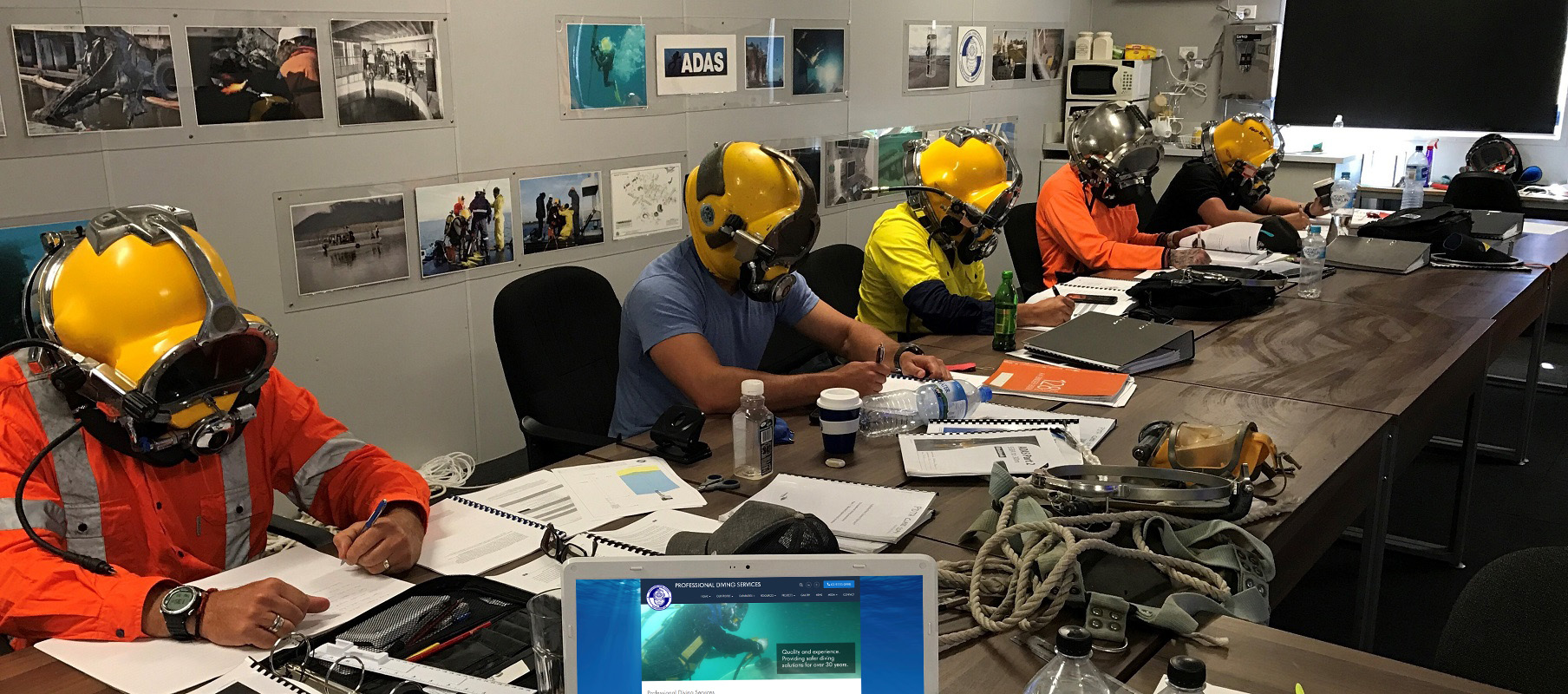 ADAS Occupational Diver Training students with helmets