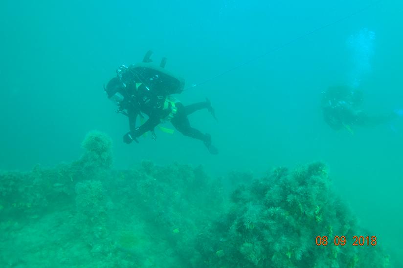 Diving student conducting vessel surveys on city of launceston