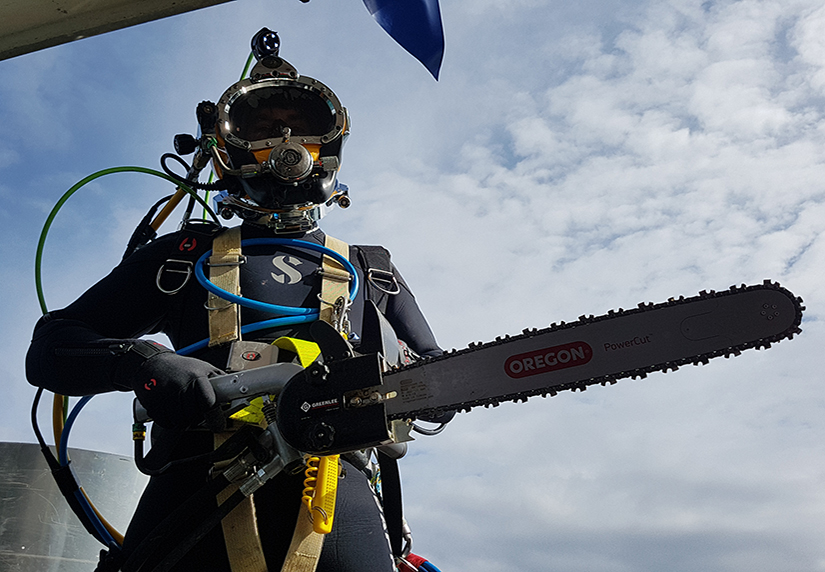 PDTA student holding chainsaw