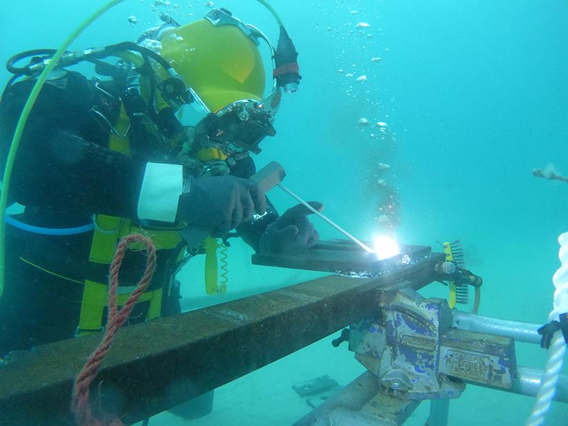 Commercial diving student welding
