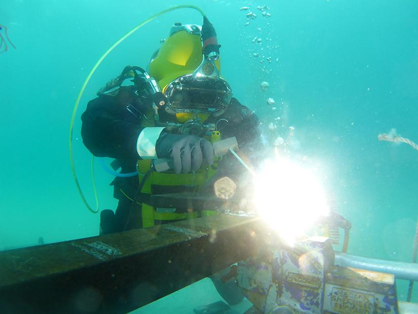 diving student welding underwater