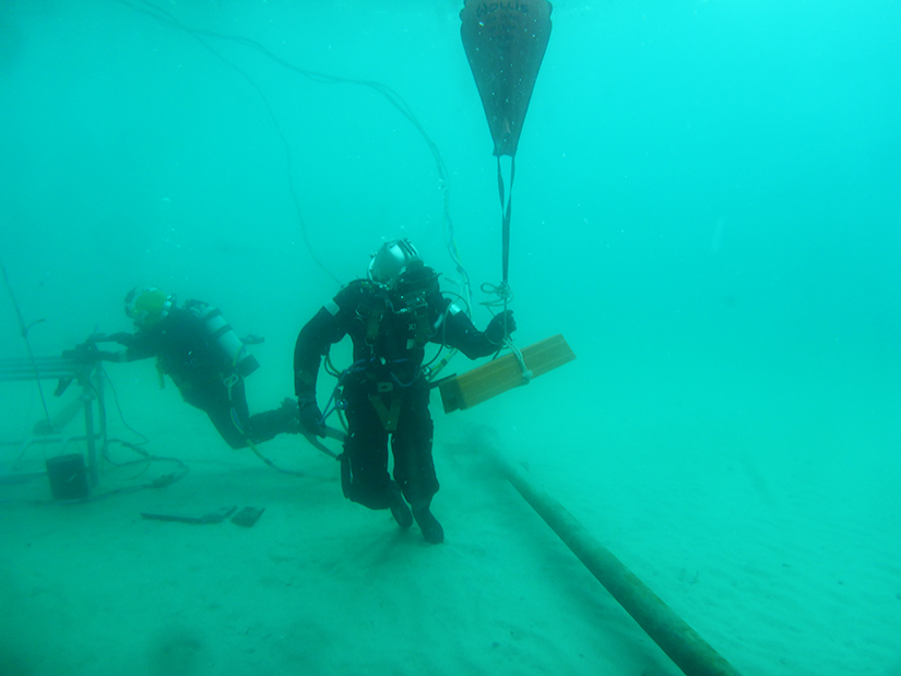 occupational diving student completing pipeline task