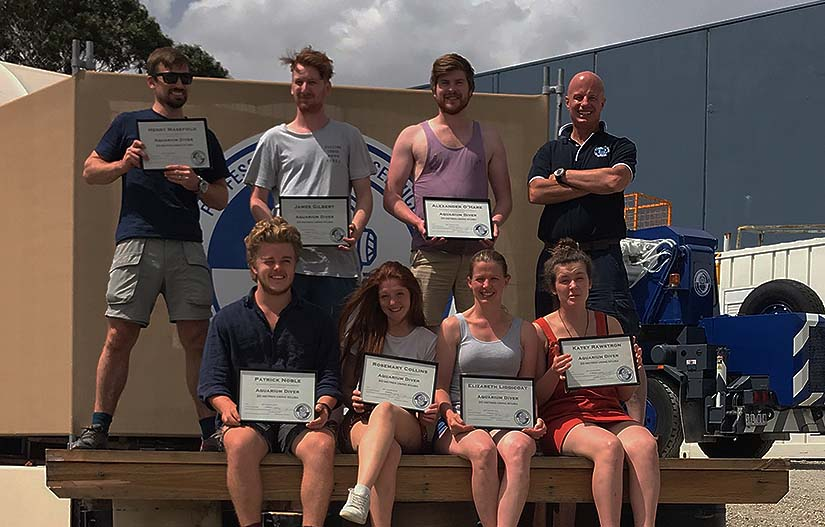 Aquarium divers with certificates