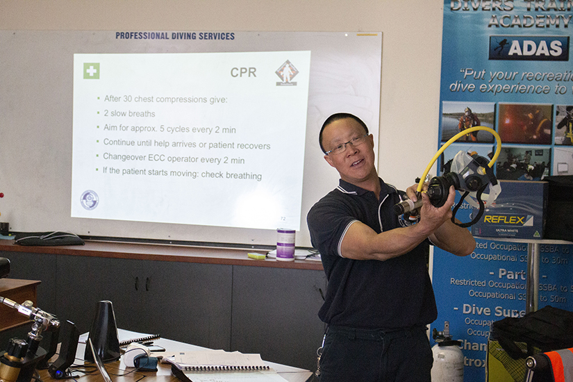 Johnny Lau CPR training with dive mask