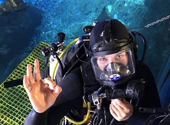 Aquarium diver preparing for a dive
