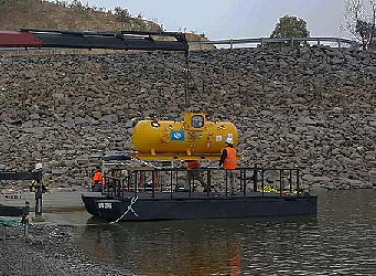 Hyperbaric chamber being loaded onto barge