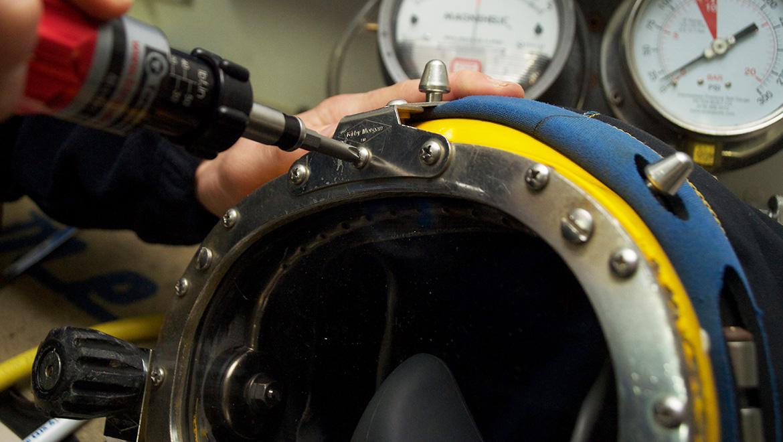 technician working on dive helmet